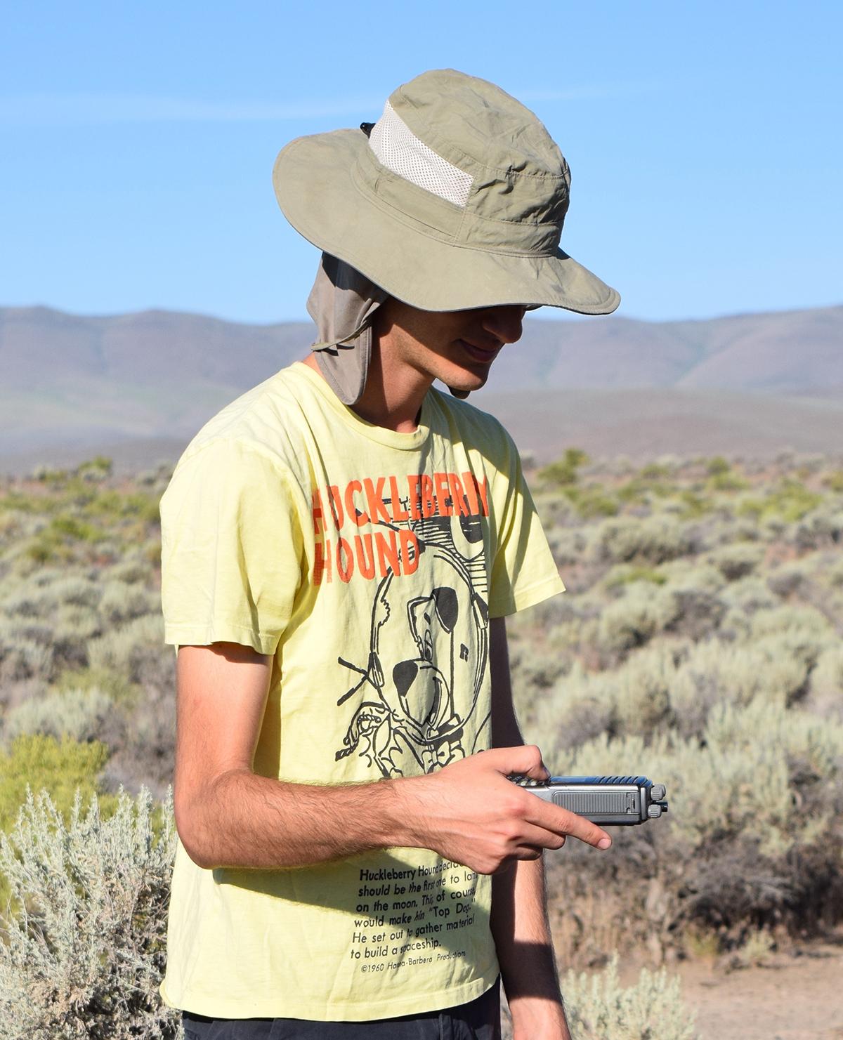 Picture of Deniz Korman doing fieldwork